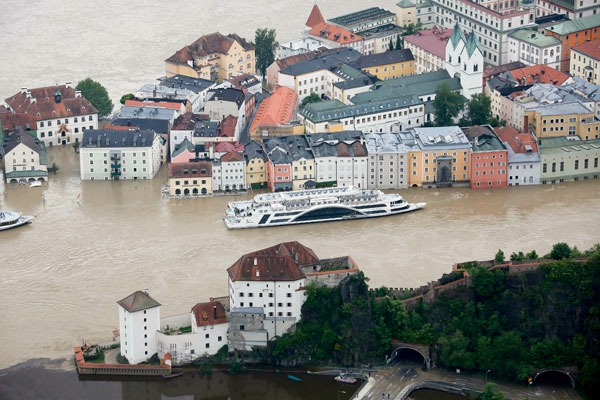 """The tourist boat """"Donau"""" (Danube) is seen on the flooded river Danube in the three-rivers city of Passau in south-eastern Bavaria June 4, 2013."""