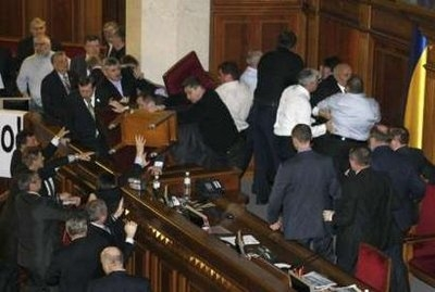 Deputies scuffle during a session in the chamber of the Ukrainian parliament in Kiev