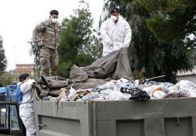 Italian soldiers collect garbage in Quarto near Naples