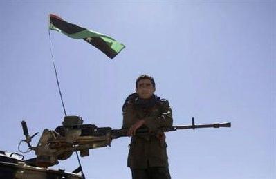 Rebel fighter stands on tank captured