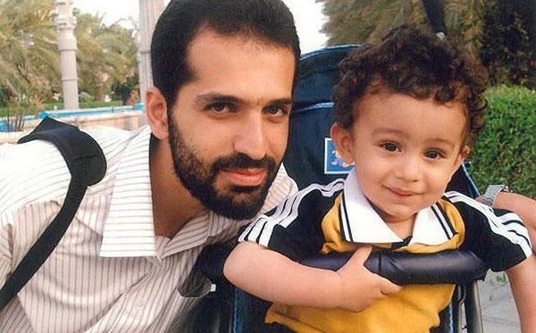 تصاویر جدید از شهید مصطفی احمدی روشن و فرزند خردسالش
