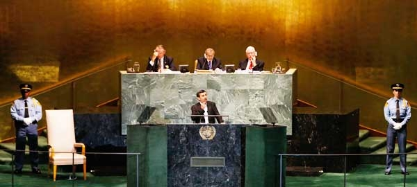 President of Iran Mahmoud Ahmadinejad gestures during his address to the 67th United Nations General Assembly at U.N. headquarters in New York, September 26, 2012.
