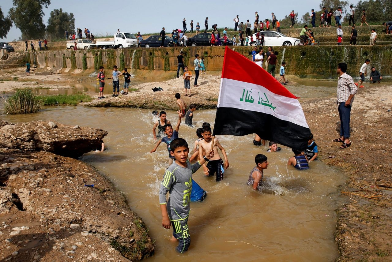 عکس روز   آببازی در موصل