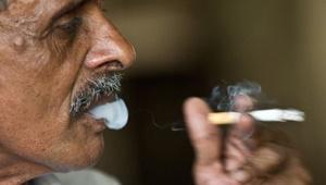 شماره تلفن ترک سیگار روی پاکت سیگارها در هند