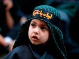 عکس روز: کودکی در مراسم عاشورا