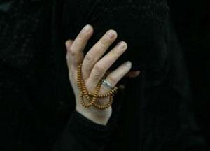 زن عزادار در حومه بیروت- محمد الذاکر/رویترز