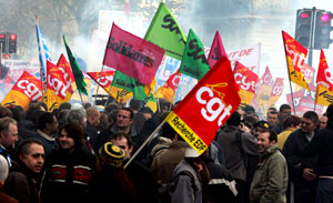 French unions launch open-ended strikes