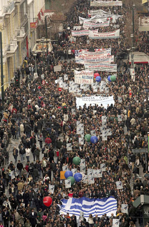 Protesters march during a mass anti-government rally in central Athens