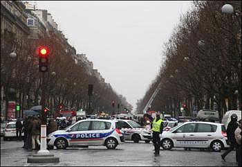 A parcel bomb explosion in central Paris killed a legal secretary and injured five others
