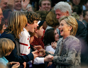 Democratic presidential candidate U.S. Senator Hillary Clinton (D-NY) greets supporters with her husband, former U.S. President Bill Clinton, at her New Hampshire primary night rally in Manchester, January 8, 2008. REUTERS