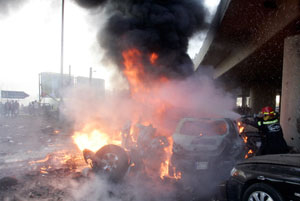 A Lebanese fireman extinguishs a fire after an explosion in the Beirut suburbs January 25, 2008. The bomb in Beirut on Friday targeted a car used by a senior police official and killed at least three people, security sources said. REUTERS