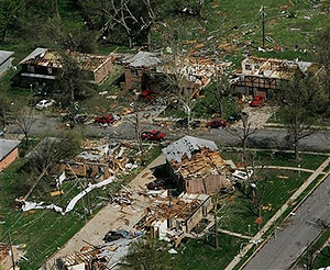 Homes damaged by severe thunderstorms are viewed from the air over Gladstone, Mo., Friday, May 2, 2008.