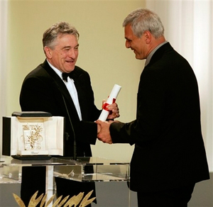 American actor Robert De Niro, left, presents the Palme d'Or for best film to French director Laurent Cantet/ AP