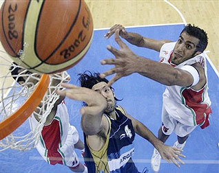 Iran's Hamed Ehadadi, right, goes for a rebound against Argentina's Luis Alberto Scola