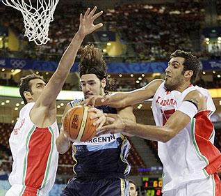 Argentina's Luis Scola, center, battles for a loose ball against Iran's Hamed Sohrabnejad, left, and Hamed Ehadadi, right
