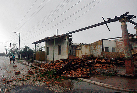 collapsed house as the eye of Hurricane Gustav passes in Los Palacios, 100 km (62.14 miles) west of Havana August 30, 2008.