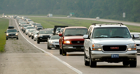 Vehicles carrying Hurricane Gustav evacuees travel along the I-10 interstate highway heading east near Ocean Springs, Mississippi, August 30, 2008