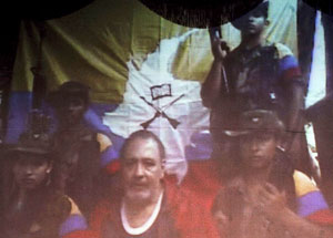 LOscar Tulio Lizcano (C), Colombian politician kidnapped since August 2000 by The Revolutionary Armed Forces of Colombia (FARC), is seen in a video