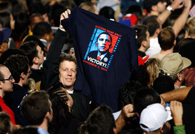A supporter of U.S. President-elect Senator Barack Obama (D-IL) holds up an Obama t-shirt during his election night rally in Chicago