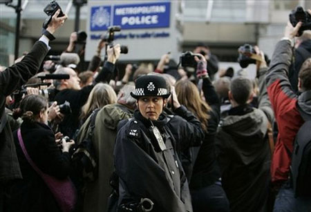 Photojournalists stage an act of mass photography outside New Scotland Yard police station on February 16, 2009 in London.