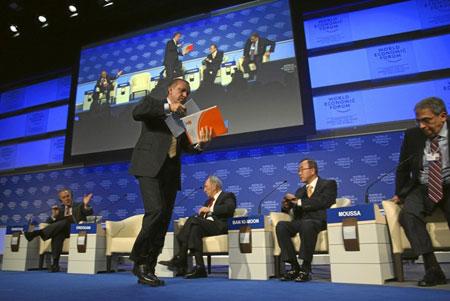 Turkey's Prime Minister Tayyip Erdogan (C) leaves  the session