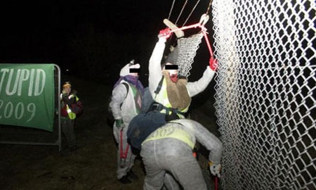 Plane Stupid climate protesters break through the perimeter fence at Aberdeen airport. Photograph: Plane Stupid/PA