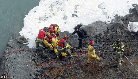 Rescuers finally pull the man from the ice-fringed Niagara River - a full half hour after he leapt in