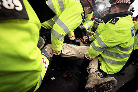 A demonstrator struggles with police during demonstrations in Bishopsgate in London, on April 1, 2009.