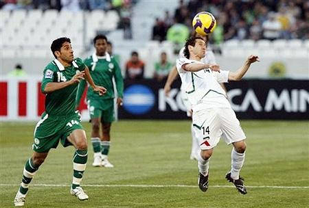 Iran's Mohammad Reza Khalatbari, right, controls the ball as Saudi Arabia's Saheb Jaseem Al Abdoullah looks on during their Asia Group 2 World Cup qualifier soccer match at Azadi stadium, Tehran, Saturday March 28, 2009.
