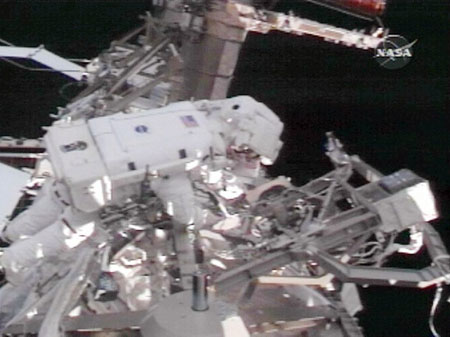 This NASA video grab shows Space shuttle Discovery Mission Specialist's Joseph Acaba (L) and Richard Arnold (R) outside of the Internationl Space Station on March 23, 2009 as they attempt to free up a rack during the third of three planned spacewalks to service items on the station.