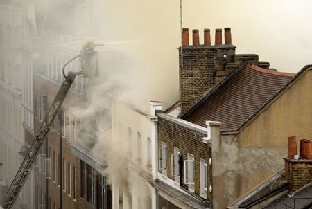 Fire crews tackle a blaze in Dean Street in central London, on July 10, 2009. Sixty firefighters from twelve fire engines have been sent to the scene. The cause of the fire has not yet been established