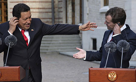 Russian President Dmitry Medvedev (R) and Venezuelan President Hugo Chavez hold a press conference after talks outside Moscow in Barvikha on September 10, 2009.