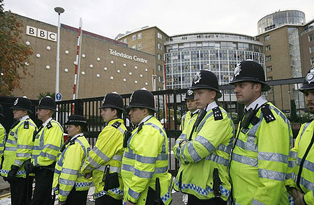 "1-	Police officers stand in front of the gates of the BBC Television Centre studios to prevent anti-British National Party (BNP) demonstrators gaining entry, in west London October 22, 2009. The planned appearance by the leader of Britain's right-wing BNP on a flagship BBC political programme on Thursday would expose the party as ""racist and unacceptable"", Prime Minister Gordon Brown said"