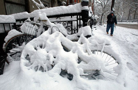 NEW YORK - MARCH 02: Bicycles are seen coverered in snow in the East Village March 2, 2009 in New York City. A large late winter snow storm hit the Northeast overnight dumping almost a foot of snow in some areas.