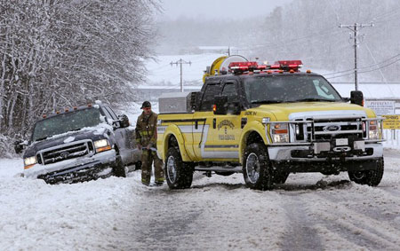 BENEDICT, MD - MARCH 02: A rescue vehicle prepares to pull a stuck truck out of the snow on March 2, 2009 in Benedict, Maryland. The Washington,DC. area was hit with a major snow storm with southern Maryland receiving the worst with 8 to 10 inches of snow.