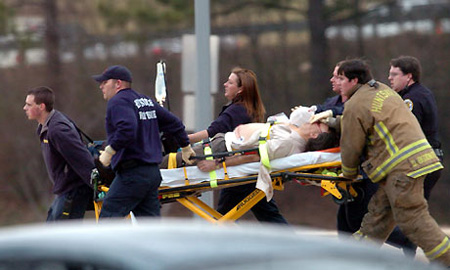 Paramedics rush a shooting victim out of the Shelby Centre at the University of Alabama's Huntsville campus Photograph: Eric Schultz/AP
