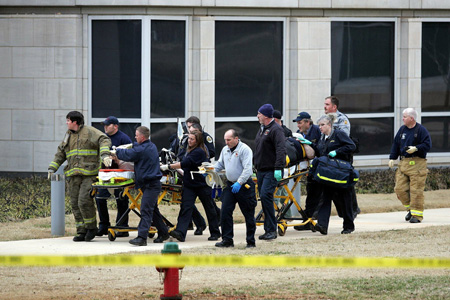 Two shooting victims are taken out of the Shelby Center at UAH