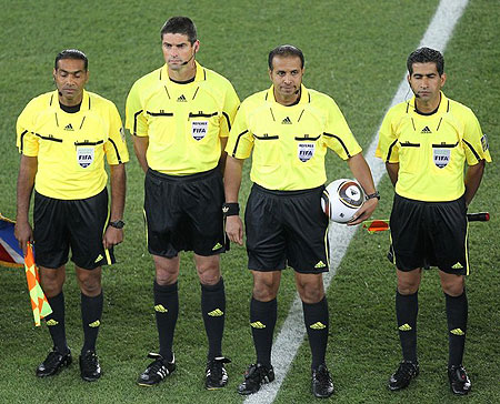 (L-r) United Arab Emirates Assistant referee Saleh Al Marzouqi, Referee Peter O Leary of New Zealand, Saudi Arabian referee Khalil Al Ghamdi , Iranian Assistant referee Hassan Kamranifar pose prior to Group A first round 2010 World Cup football match France vs Mexico on June 17, 2010 at Peter Mokaba stadium in Polokwane.