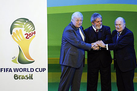 razilian President Luiz Inacio Lula da Silva (C), Brazil 2014 World Cup organizing committee president Ricardo Texeira (L) and FIFA president Joseph Sepp Blatter (R) join hands as they celebrate the official launch of the FIFA World Cup 2014 Brazil Logo on July 8, 2010 at the Sandton Convention Center in Johannesburg.