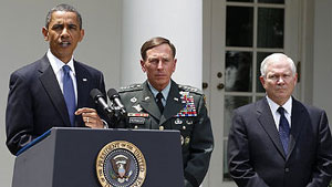 Obama announces Gen. David Petraeus, center, will replace Gen. Stanley McChrystal in Afghanistan as Secretary of Defense Robert Gates listens.
