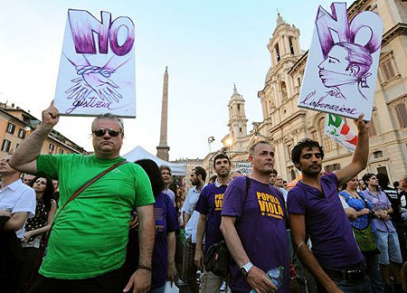"""Demonstrators holds banners during a rally against the so called """"gag law"""" in Rome on July 1. Virtually no news was published in Italy as journalists went on strike against a bill curbing the use of wiretaps and their publication proposed by the government of Silvio Berlusconi."""